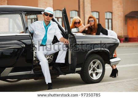 Young people with a retro car - stock photo