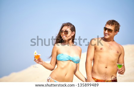 Young people with cocktails having summer vacation - stock photo