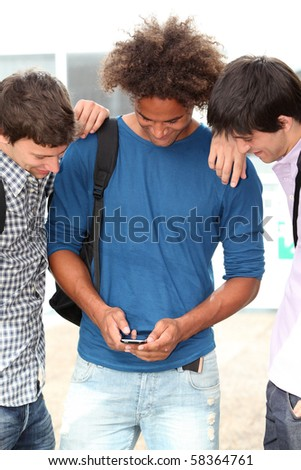 young people with mobile phone at college campus - stock photo