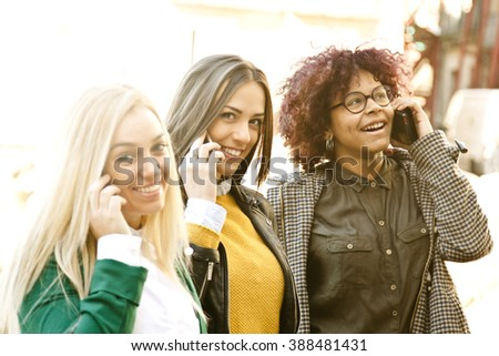 young people with smartphone on street