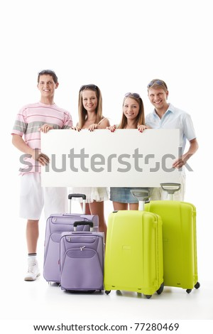 Young people with suitcases and empty billboard on a white background - stock photo