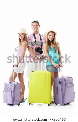 Young people with suitcases on a white background - stock photo