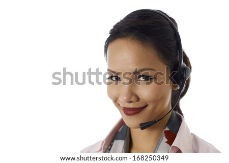 Young people, work and technology, portrait of happy Asian girl working as call center operator with headset, customer care representative, smiling at camera - stock photo