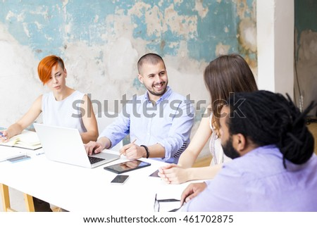 Young people working by the desk in the grunge office