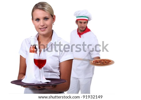 Young people working in a restaurant - stock photo