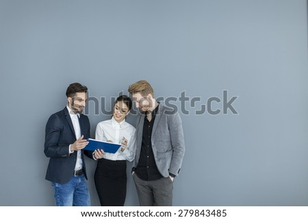 Young people working in the office - stock photo
