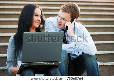 Young people working on laptop - stock photo
