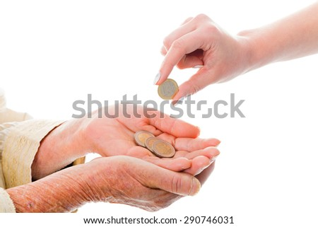 Young person donating money to senior beggar -  Euro on image. - stock photo