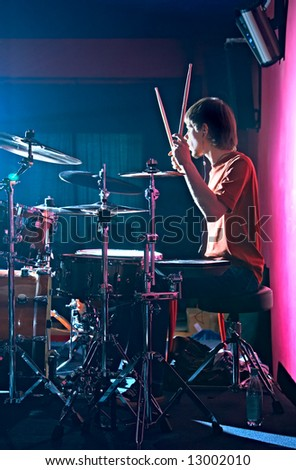 young person playing on drum in club