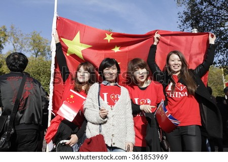 Young person poses with China flags  in London , UK, 20th October 2015. The President of the Peoples Republic of China, Mr Xi Jinping and his wife, are paying a State Visit to the UK.