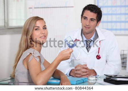 Young person showing European health card - stock photo