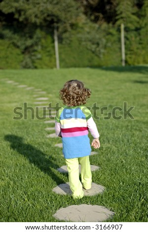 young person walking away, very independent young girl - stock photo