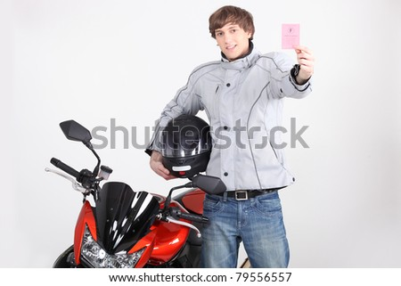 Young person with motorbike license - stock photo