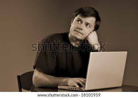 Young person works on the computer - stock photo
