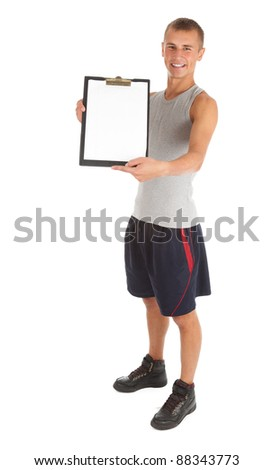 young personal trainer keeping balank clipboard, white background - stock photo