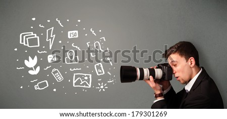 Young photographer boy capturing white photography icons and symbols - stock photo