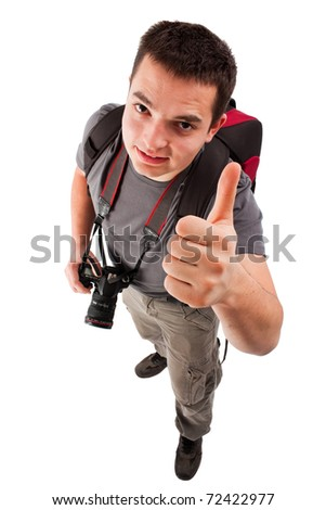 Young photographer looking at the camera, smiling and with thumbs up.
