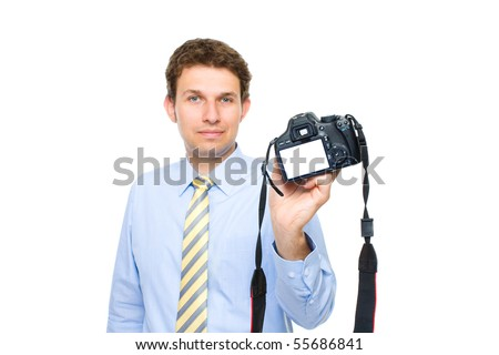 young photographer shows empty dslr back screen, copy space, studio shoot isolated on white background - stock photo