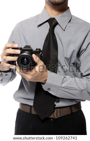 Young photographer take picture using analog SLR Camera - stock photo