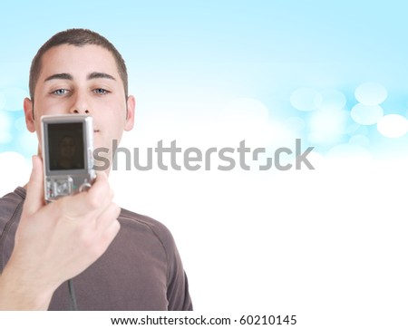 Young photographer taking a picture with is camera - stock photo