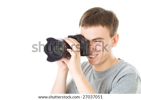 Young photographer with camera. Isolated on white background