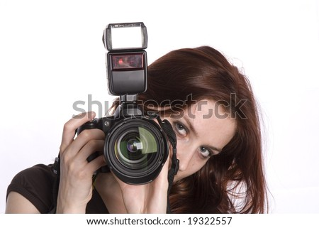 young photographer with digital camera isolated on white - stock photo