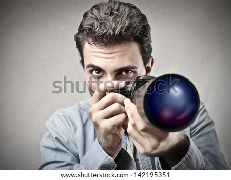 young photographer with professional camera - stock photo
