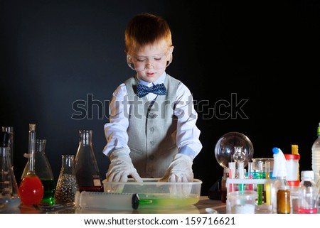 Young physicist experimenting with the reagents