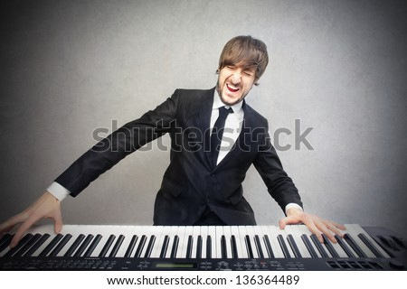 young pianist playing piano - stock photo