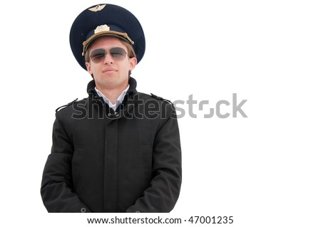 young pilot isolated with copyspace with glasses and black coat