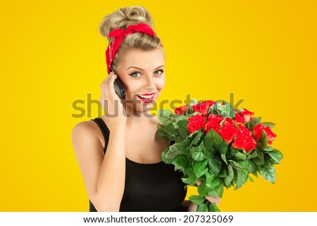 Young pin-up style woman talking by mobile phone - stock photo