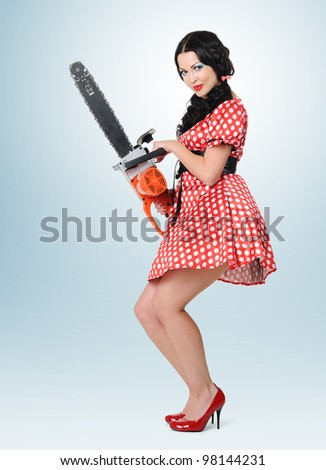 Young pin-up woman with electric saw, concept - stock photo