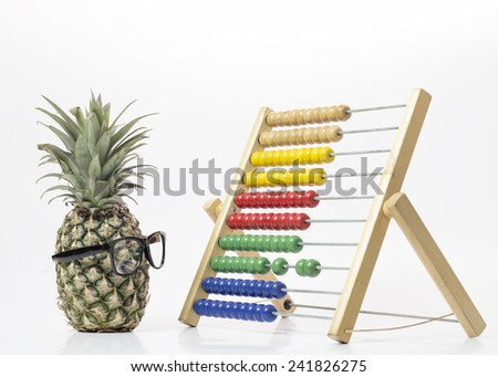 Young pineapple learning abacus. - stock photo