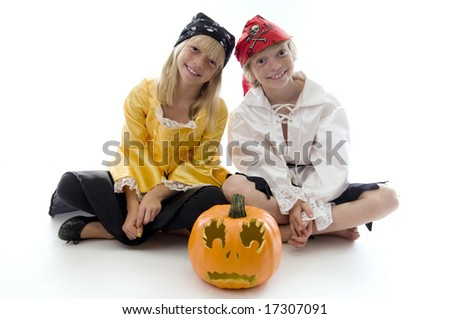 Young Pirate Twins Ready to Pillage and Plunder! - stock photo