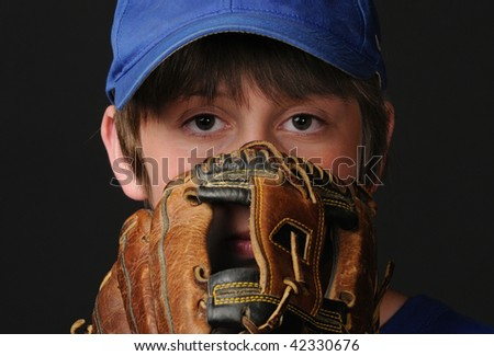 Young pitcher looks in for his baseball signs - stock photo