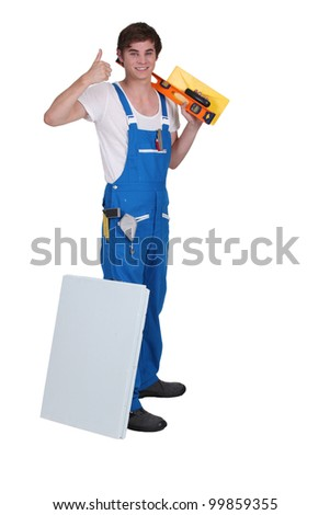 Young plasterer with tools of the trade - stock photo