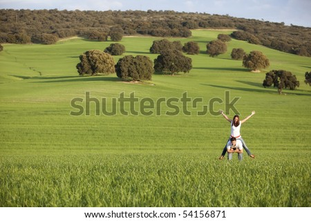 Young playful couple enjoying on nature - stock photo