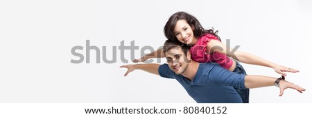 young playful involved couple posing as flying - stock photo