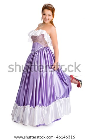 Young playful smiley woman in ball dress - stock photo