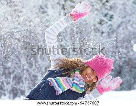 young playful woman has a fun winter time in a snow park - stock photo