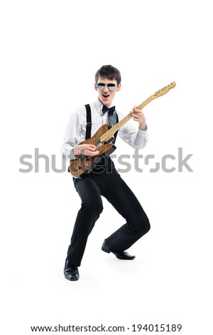 Young playing guitarist against white background