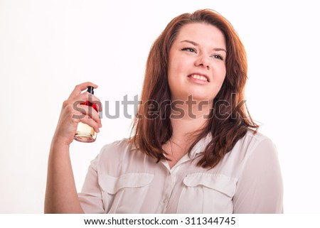 Young plump girl spray fumes on white