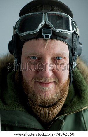 Young polar pilot in alaska green jacket and flying helmet