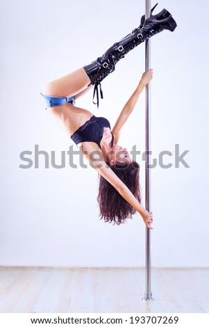 Young pole dance woman.