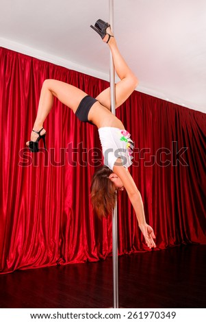 Young pole dance woman - stock photo