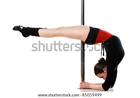 Young pole dance woman doing gymnastics against a white background - stock photo