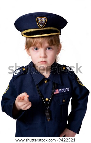 Young police girl sternly pointing at you.  Isolated on white. - stock photo