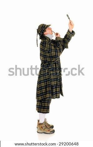 Young police officer dressed up as Sherlock Holmes investigating crime scene, white background - stock photo
