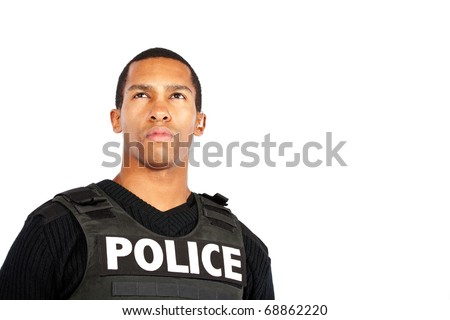 young police officer watches for trouble - stock photo