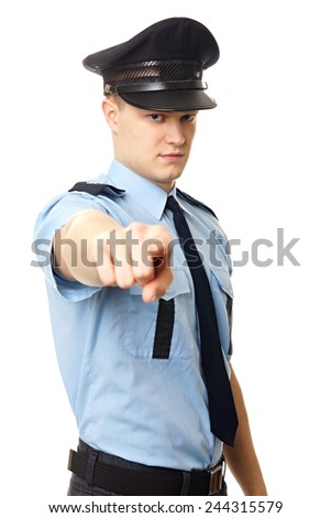 Young policeman shows on you on white background